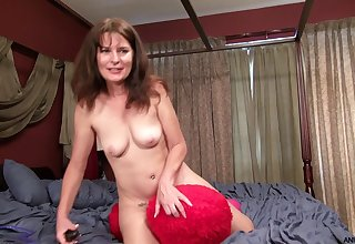 Dirty mature Shelby Ray moans while pleasing her soft pussy
