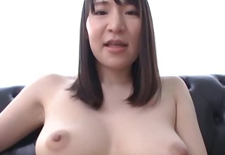 Solo hottie Masaka Matsuoka playing with some toys on the couch