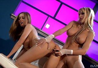 Anita Menacing and Angie Fleshly use a dildo to reach a unafraid orgasm