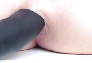 Maroon German milf sticks dildo in anal