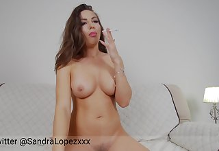 Webcam model smokes a cigarette on her show
