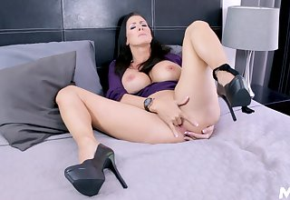 matured on high heels enjoys solo time in bed