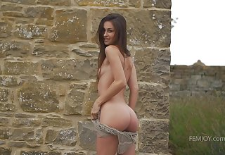 Slim and X-rated Ukrainian girl Demi Fray strips and goes unassisted outdoors